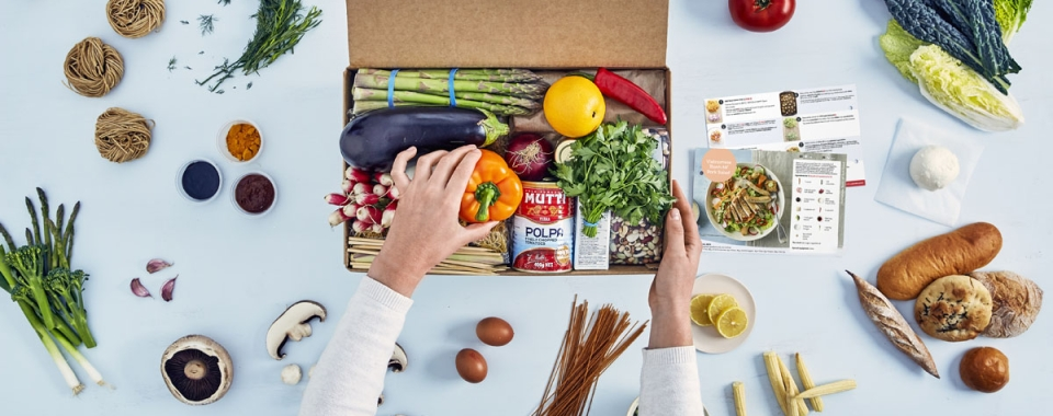 Meal kit and ingredients spread across counter